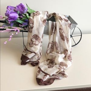 Brown and tan scarf with skull print